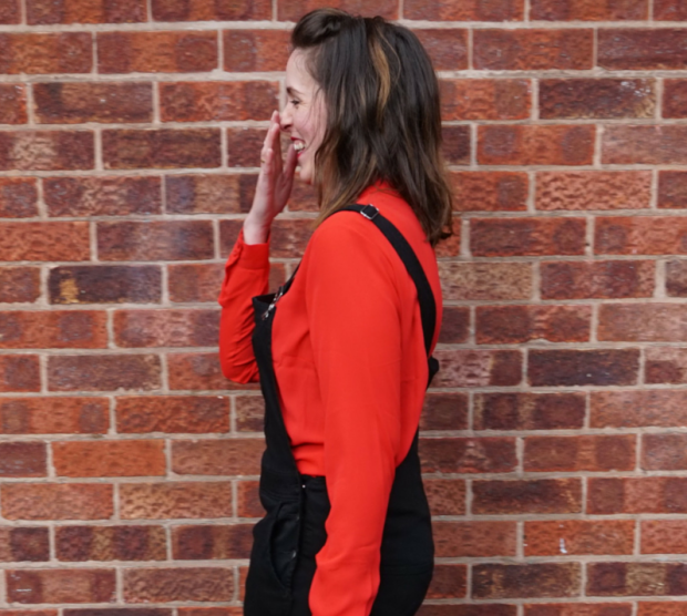 laughing dungarees and red blouse