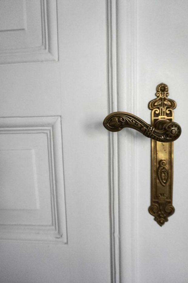 stunning vintage door handle in period feature filled Berlin airbnb Apartment