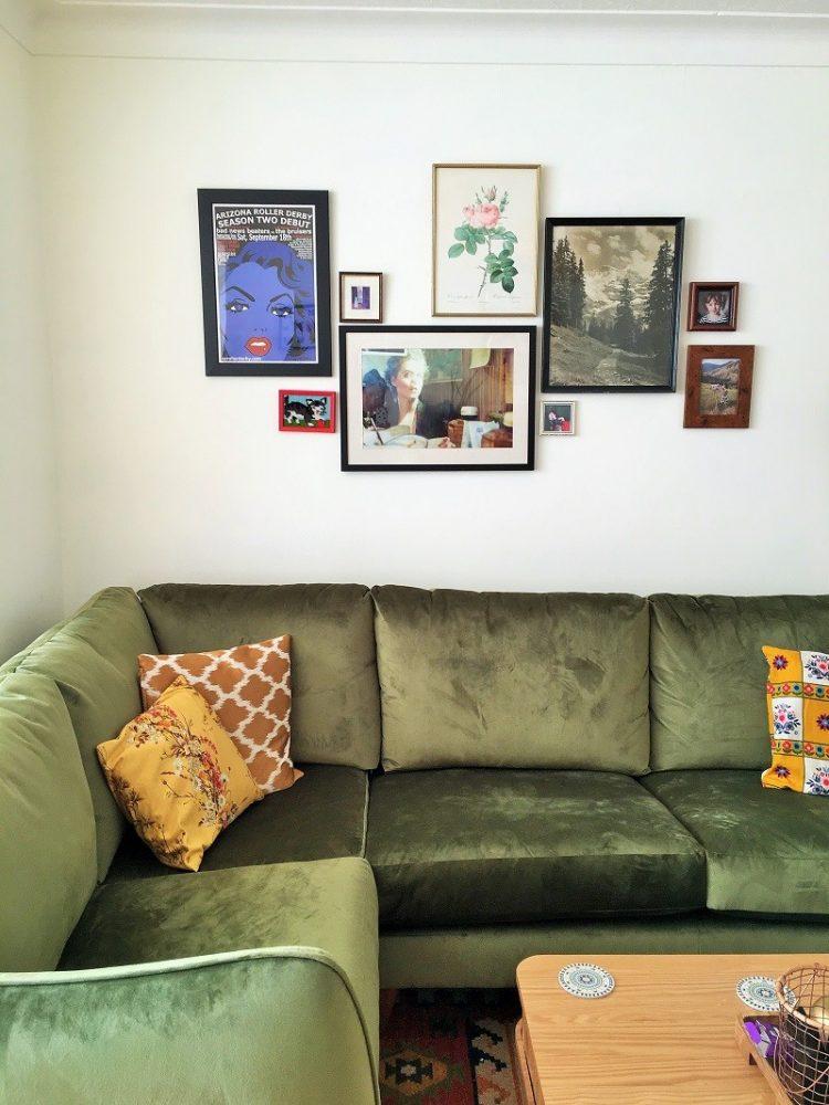 gallery wall bohemian living room with green velvet corner sofa