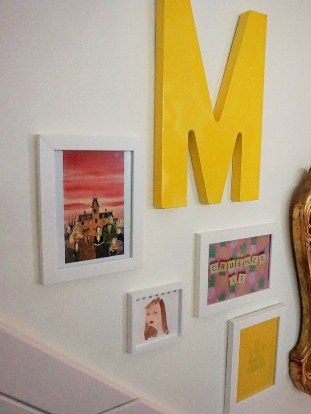 gallery wall in yellow kids room