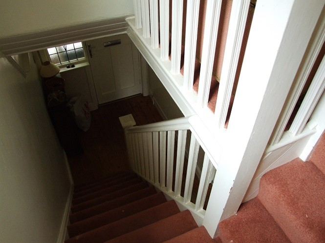 dated stairs with carpet pre makeover