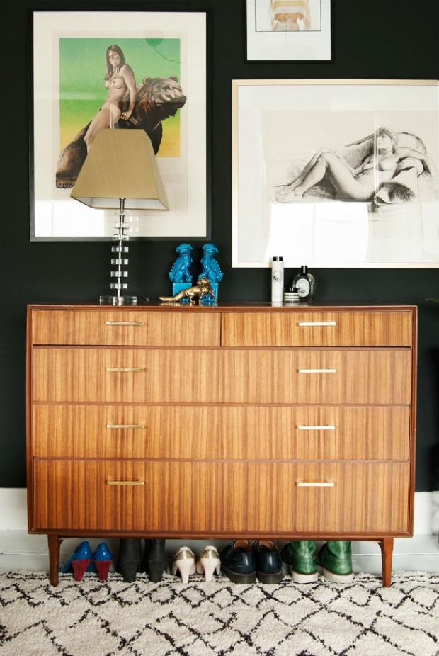 gallery wall in bedroom with vintage drawers