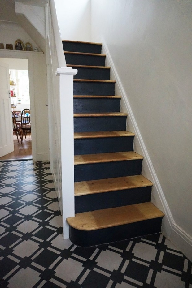 black risers and wooden treads staircase
