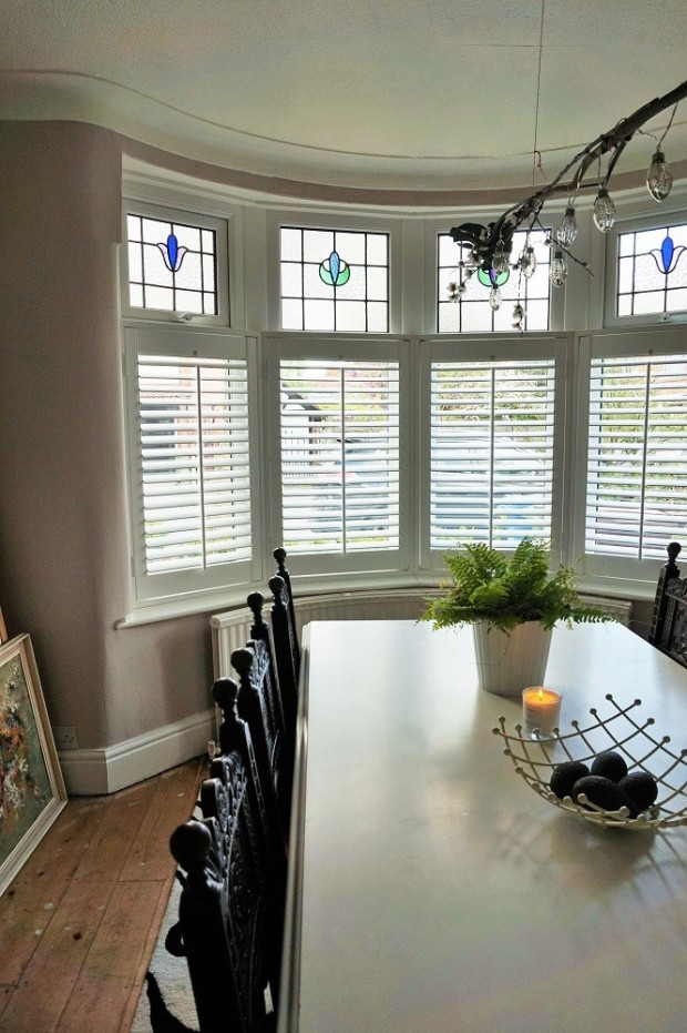 shutters in edwardian bay window vintage home