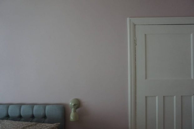 pink walls blush with white door and grey headboard