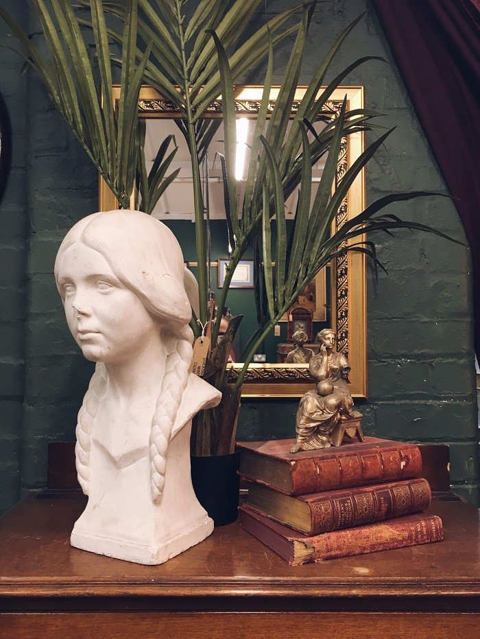 vintage vignette plaster bust and stacks of books manchester
