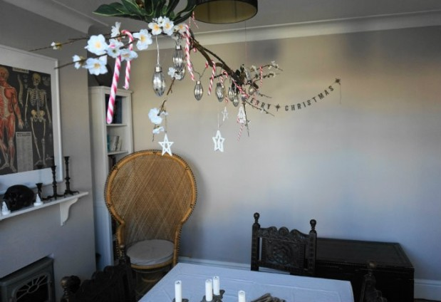 hanging branch decor above table