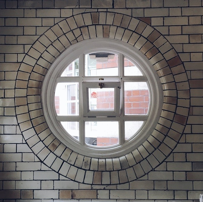 round tiled window in manchester