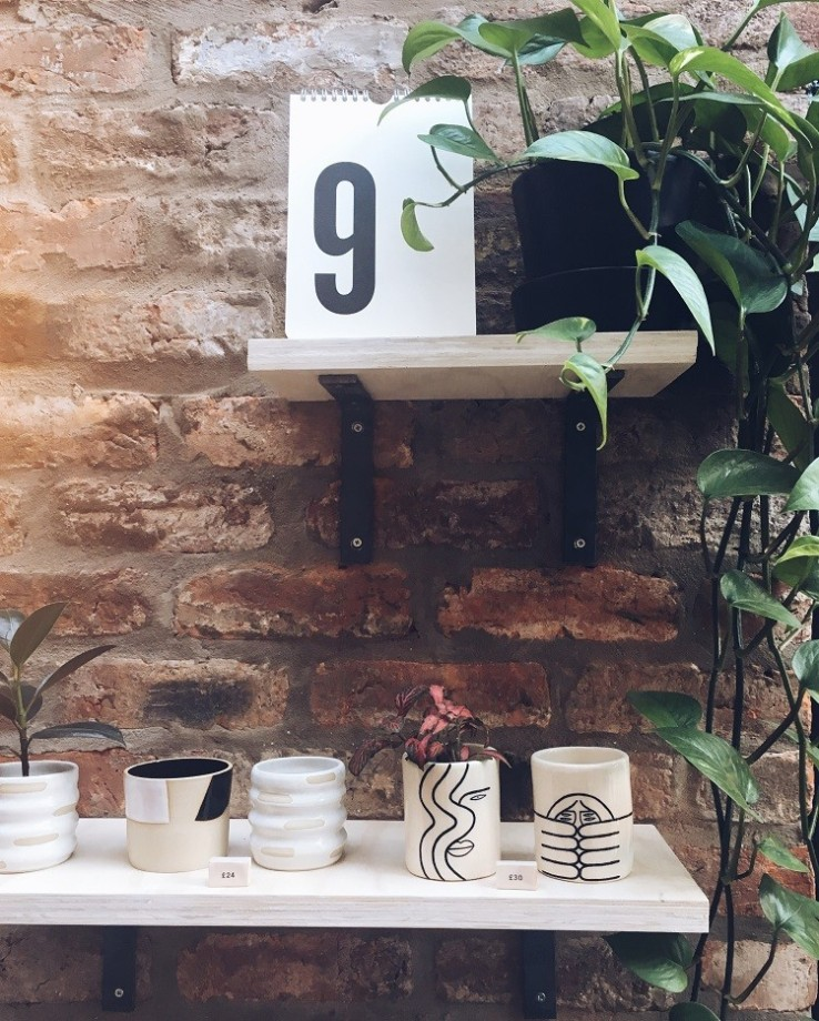 form lifestyle plant shelf pretty planters exposed brick