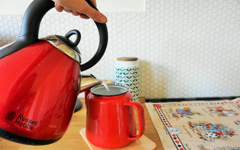 old fashioned susie enamel teapot red on hexagon tiles