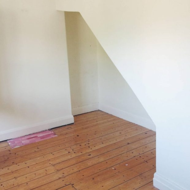 attic conversion created understairs area in bedroom