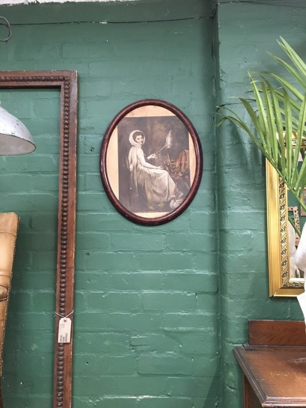 green walls and wooden frames vintage bohemian style
